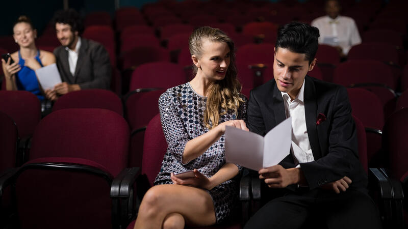 couple reading in theatre